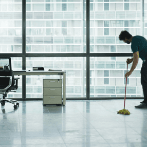 Commercial Cleaning - Office floor being mopped